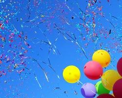 multicolored balloons and confetti in the city festival #4