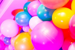 Multicolored balloons. Blue, yellow, pink baloons, close up