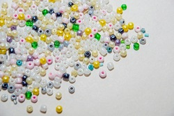multicolored beads, beads for needlework, background with beads, close-up, scattered beads