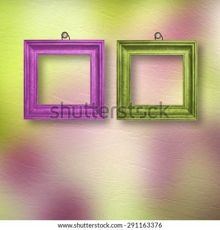 Multicolored bright frames hanging on the abstract pastel background
