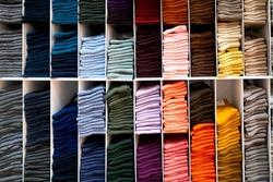 Multicolored bright socks on shelve in store