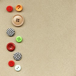 Multicolored buttons on the background fabric