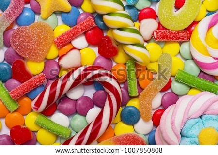 Multicolored candy and lollipops on a white background. #1007850808