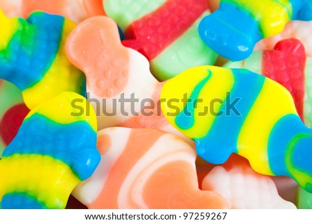 Multicolored candy fish shaped. Background