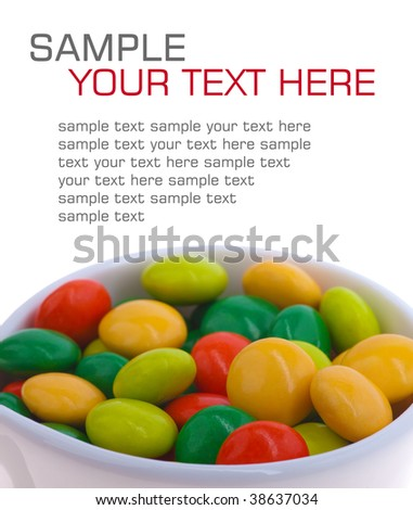 multicolored candy in a cup. isolated on white
