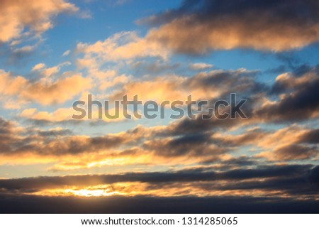 multicolored clouds at dawn. bright sky filled with sun, the morning of a new day. active awakening of the world #1314285065