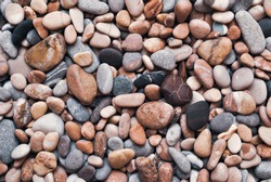 Multicolored colorful sea pebbles, natural background, texture. Close-up texture of colorful sea pebbles. Small Rock. Sea background