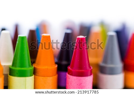 Multicolored crayons on a white background.
