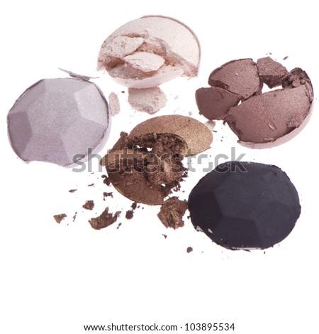 multicolored crushed eyeshadows isolated on white background