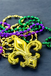 Multicolored decorations for Mardi Gras party on the table.