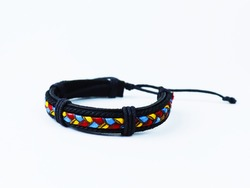 Multicolored ethnic braided bracelet on a white background.