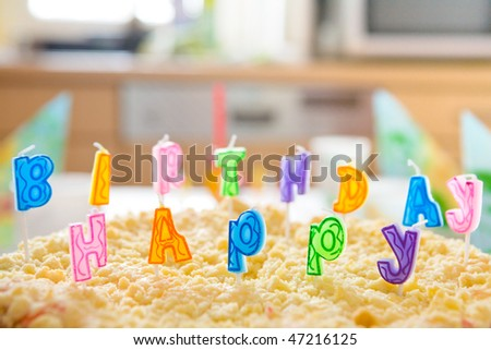 multicolored happy birthday letters on a streusel cake shallow depth of field