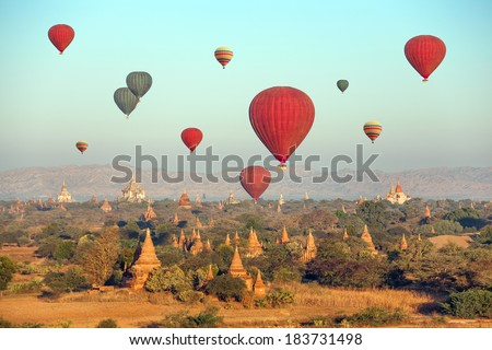 Multicolored hot air balloons over Buddhist temples at sunrise Bagan MyanmarCanon 5D Mk II
