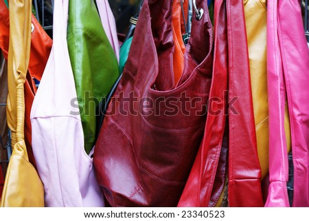 multicolored leather bags on street market