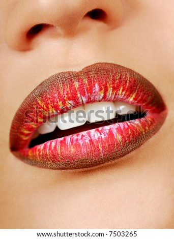 Multicolored lipstick. Beautiful and shine woman lips. Bright make-up.