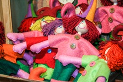 multicolored little dolls in wool fabric