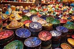 Multicolored painted ceramic oriental plates in the market at Medina. Marakesh. Morocco. Oriental interior design
