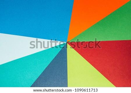 Multicolored paper. Multicolored buckground #1090611713
