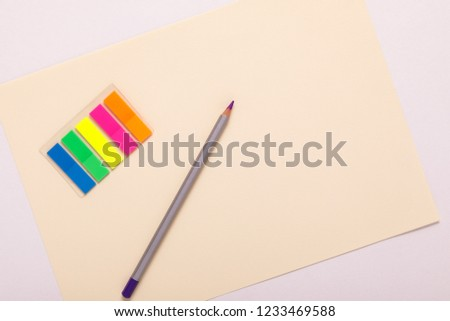 multicolored pencils and multicolored paper, top view #1233469588