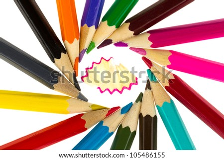 Multicolored pencils and wood shavings isolated on white