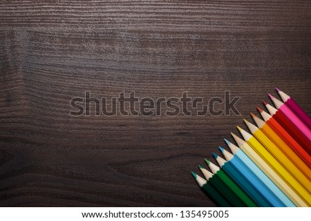 multicolored pencils on the brown wooden table background #135495005