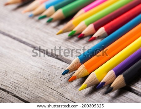 multicolored pencils on the wooden  background #200305325