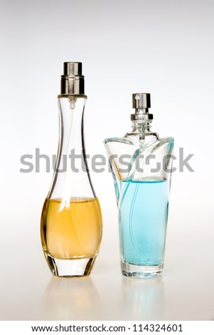 Multicolored perfumes in bottles of different shapes