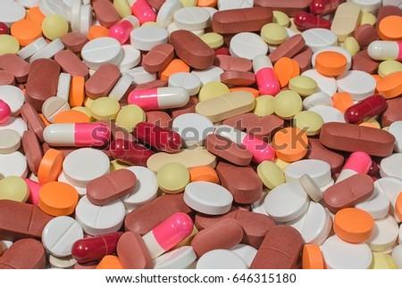 Multicolored pills background #646315180