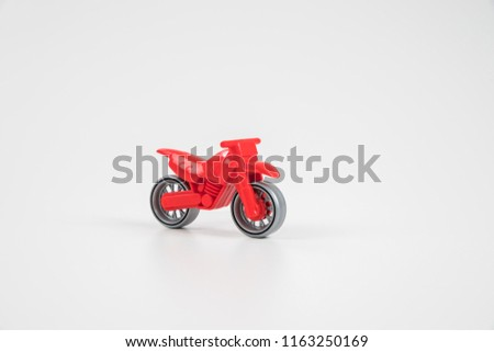 Multicolored plastic toy car. Motorcycle.
