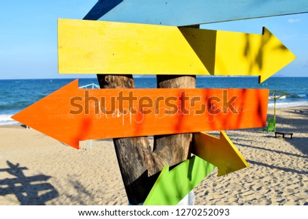 Multicolored pointers on the beach  #1270252093
