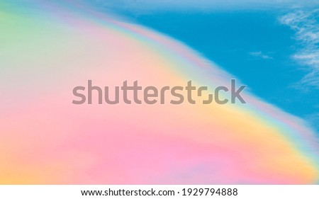 Multicolored rainbow cloud in natural sky background. Unusual and beautiful meteorological atmospheric phenomenon called irisation or iridescent. Circumhorizontal arc or rainbow of fire cirrus clouds. Photo stock ©