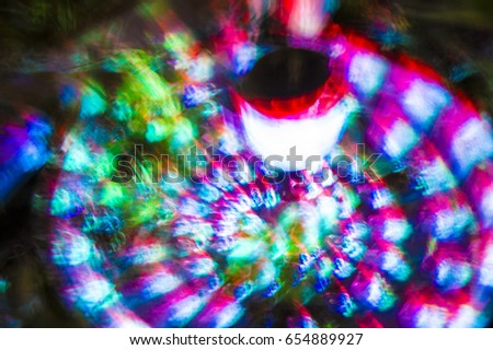 Multicolored reflections of light from a streetlight background texture #654889927