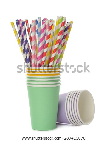 Multicolored retro straws in a paper cup, isolated on white background