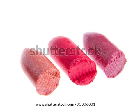 Multicolored scraps of lipstick isolated on white background
