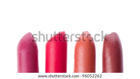 Multicolored scraps of lipstick isolated on white background - stock photo