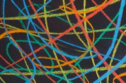 multicolored scribbles  on black paper  background