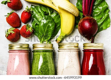 Shutterstock Multicolored smoothies and juices from vegetables, fruits and berries, food background, top view