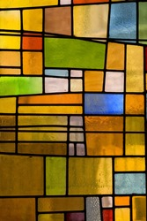 Multicolored stained glass church window, portrait orientation