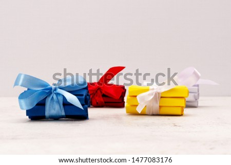 Multicolored stop tickets, tied with a gift bow. Creativity and creativity