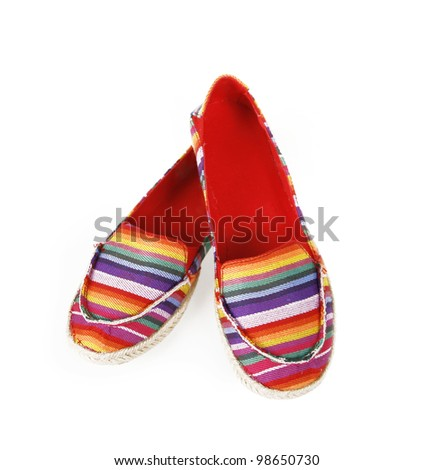 multicolored striped flat shoes isolated on white