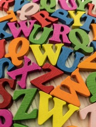 multicolored uppercase letters on white background