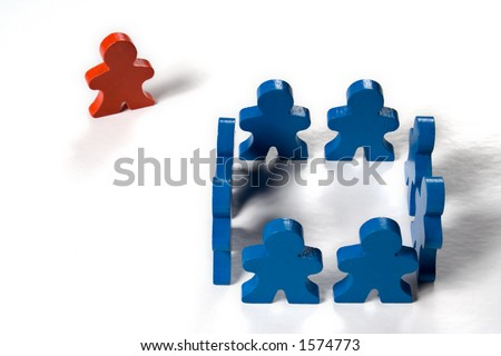 Multicolored wooden people illustrating a business concept - thinking outside the box.