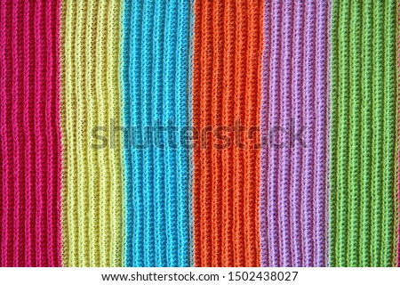 multicolored woolen soft texture striped. striped pattern fabric wool.  knitted blanket from multi-colored threads. Strips Backgrounds. #1502438027