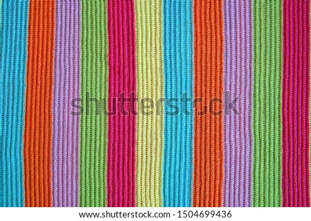 multicolored woolen soft texture striped. striped pattern fabric wool.  knitted blanket from multi-colored threads. Strips Backgrounds. #1504699436