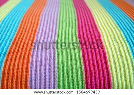 multicolored woolen soft texture striped. striped pattern fabric wool.  knitted blanket from multi-colored threads. Strips Backgrounds. #1504699439