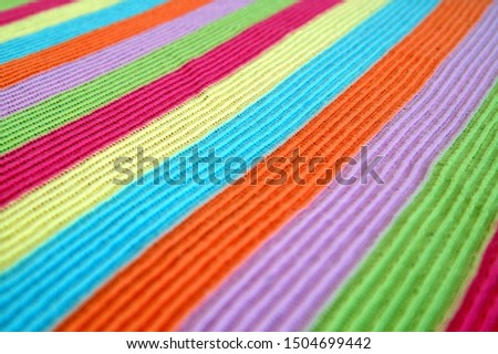 multicolored woolen soft texture striped. striped pattern fabric wool.  knitted blanket from multi-colored threads. Strips Backgrounds. #1504699442