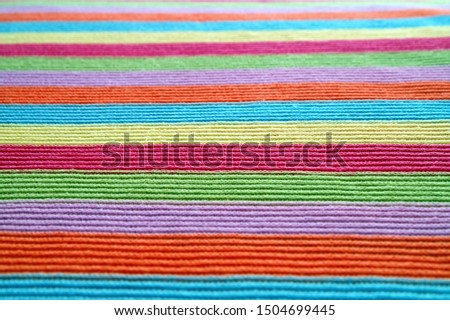 multicolored woolen soft texture striped. striped pattern fabric wool.  knitted blanket from multi-colored threads. Strips Backgrounds. #1504699445