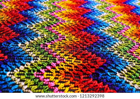 Multicolored zigzag patterns on traditional shawl in Moldova	 #1213292398