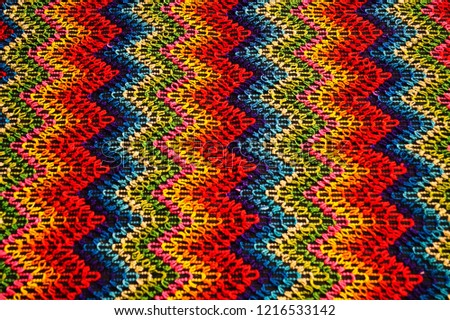 Multicolored zigzag patterns on traditional shawl in Moldova			 #1216533142