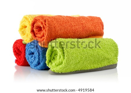 Multicolour towels rolls reflected on white background - stock photo